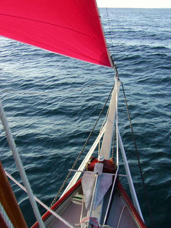 The morning sun brightens up the bowsprit and its supports as the north northwest winds favor our course of 160 degrees.