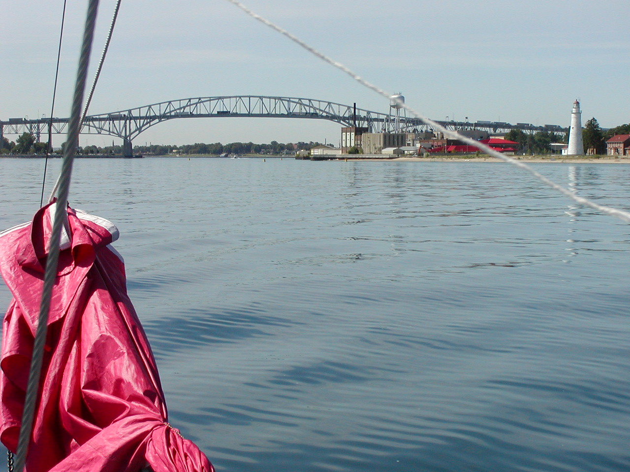 This bridge at the mouth of the St. Clair River connects Port Huron, USA with Sarnia, Canada. The lack of wind makes this a motoring day. We need to be going a few knots faster than the current in order to control steering. The river current seems to range from 3-4 knots.