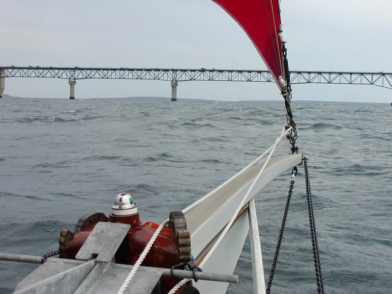 The 32 foot mast will pass easily under the lower beams of the southern section of the bridge.  We reach it at 3:00 pm.  We are making good speed on a beam reach so decide to continue on to Cheboygan.