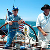 "Captain Kevin shows a guest the ropes aboard Columbia! (Source: <a href=""http://12meterchartersnewport.blogspot.com/2010_09_01_archive.html"">http://12meterchartersnewport.blogspot.com/2010_09_01_archive.html</a>)"