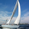 "Columbia yacht in Newport Harbor (Source: <a href=""http://12meterchartersnewport.blogspot.com/2010_09_01_archive.html"">http://12meterchartersnewport.blogspot.com/2010_09_01_archive.html</a>)"