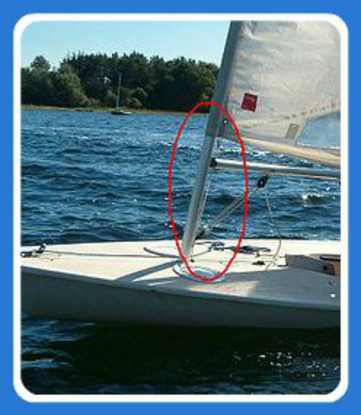 """Cunningham """"downhaul"""" (A Cunningham is """"a common device on sailboats that adjusts sail tension.) Source: Wikipedia."""