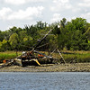 Burned Shrimp Boat in the East River at Downtown Brunswick, Ga. Look for the Osprey on the Structure.