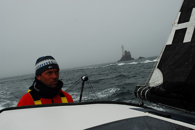 Rob Greenhalgh at the helm passing Fastnet Rock.