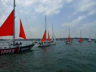 Yachts parade their storm sails before the race start.
