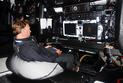 Capey in front of the navigation console at night.