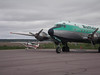 Tucked under the wing of a DC-4 at Inuvik airport