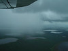 Skirting a rain squall as we approach Inuvik