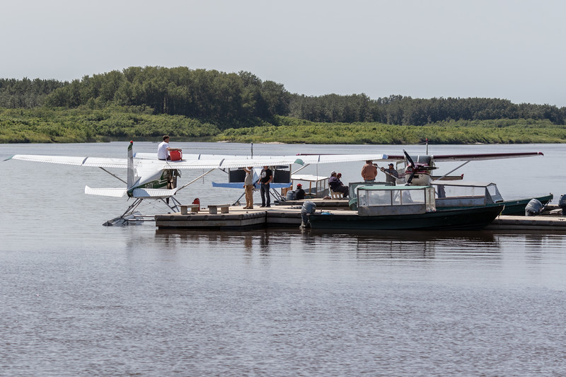 Three floatplans at public docks in Moosonee 2018 August 18.