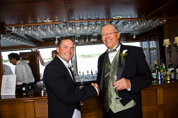 Wedding ceremony in front of the Grand Belle's full walnut bar.