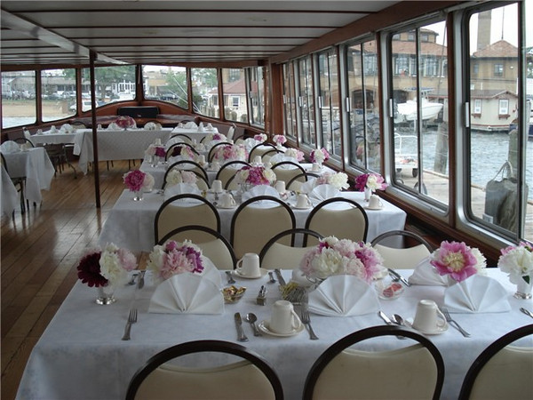 Sit down table seating on the main deck of the Grand Belle.