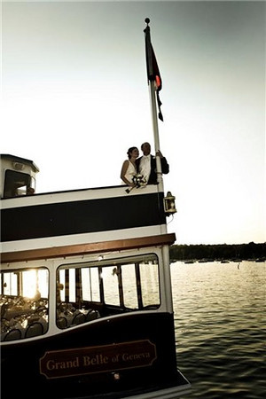 Wedding couple on the bow of the Grand Belle.