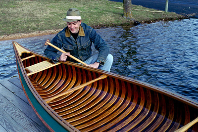 16' 1941 Old Town  Sure, I'm smiling now, but this boat caused me a lot of pain. It came very close to ending up in the kindling box. No, I didn't build it - but with the same time and money it took me to restore it I could have built two new canoes.