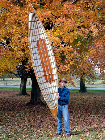 Snowshoe12 Ultralight Canoe - Gary  Did I mention these boats are light?  I stretched this canoe from the 12 ft design. This boat was built for display purposes, only - a prop at Big Cedar Lodge in Branson - so I omitted the Kevlar roving.