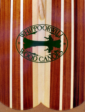 Canoe Paddle1b  The dark wood is western red cedar and the lighter wood is mostly sitka spruce.   My logo - designed by my brother, David Wright - is silkscreened on rice paper under the fibergglass which encapsulates the blade.