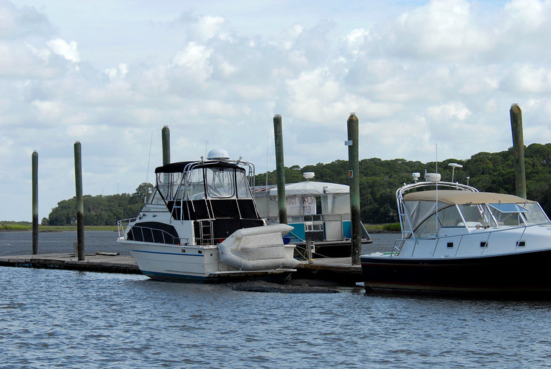 Jekyl Wharf Docks along the ICW in Jekyll Creek at low tide with boats sitting on the bottom and the mud extending beyond them on July 28, 2008