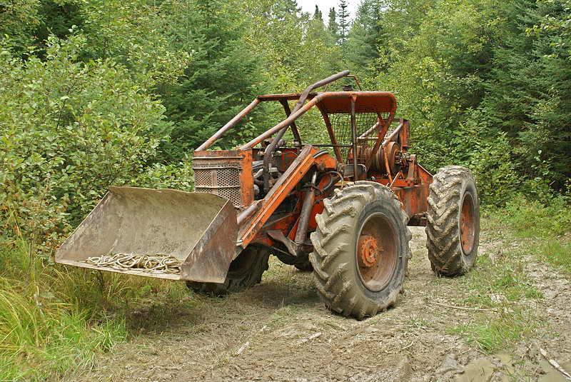 """This is the skidder that ended up pulling the truck out of the mud. Considering the power of this puppy, it still took a bit of pulling just to get the truck moving.  Needless to say, I didn't get back to work in time for the next flight.         <A HREF=""""#top""""><TD vAlign=top noWrap align=right bgColor=lightblue><FONT face=""""Verdana, Arial, Helvetica"""" color=#4F94CD size=1>Top</FONT></TD></A>"""