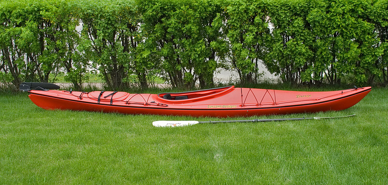 """<TD vAlign=top noWrap align=right bgColor=lightblue><FONT face=""""Verdana, Arial, Helvetica"""" color=#4F94CD size=3>My Kayaking Adventures</FONT></TD>  On May 18th (2007), I drove the 90 minute drive to Kenora, Ontario to meet with 'Heather' of the Hardwear Company. I've being talking with her over the phone about purchasing a kayak and I was finally going to meet up with her in person to try one out.  After finally finding a parking spot fairly close to the store, I went in to meet with Heather. After a brief introduction, we drove to the warehouse where we took two Current Designs kayaks out and down to the dock. The model I was going to be trying out was the Current Designs Breeze, a 13 ½ foot boat. Heather was going to be in a Whistler – a 14 ½ foot boat.  She explained a few things like how to actually get into a kayak without going for a swim, how to hold and use a paddle, how to place the boat into the water, and how to remove it from the water without hurting your back!  I got into the boat while it was still on the dock so I could adjust the foot pedals – and to see if I could actually get into the kayak!  She placed the boat into the water to show how you do it, then let me try to get in. After safely getting in to the boat, she had me wiggle my hips a bit which of course rocked the boat. This made me a little nervous as I've never being in a kayak before and didn't want to flip it over. I soon felt at ease so I paddled away from the dock so that Heather could get into her own boat.  She let me try two different models of paddles that where also of two different lengths (and of course two different prices) but after trying each, it was apparent that the second, the longer of the two at 230 cm's, was my favorite and yes it was the more expensive one.  The Breeze also comes with a rudder which made it much easier for me to maneuver the boat without relying on how I paddled. I think one should learn how to properly paddle a kayak first but personally I'm really g"""
