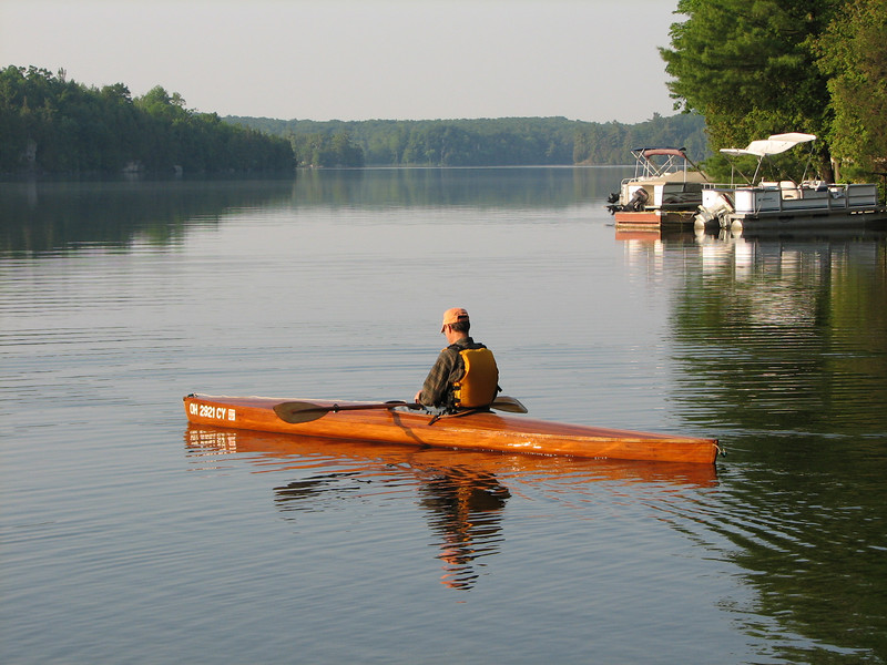 Leon sets out on my cedar strip kayak for a morning run.