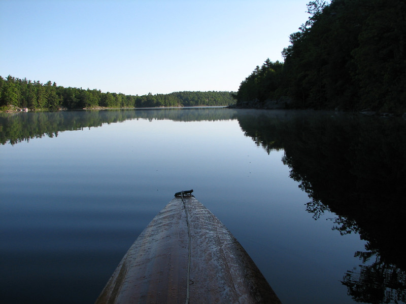 With morning dew still on the bow, the lake is quiet and still.