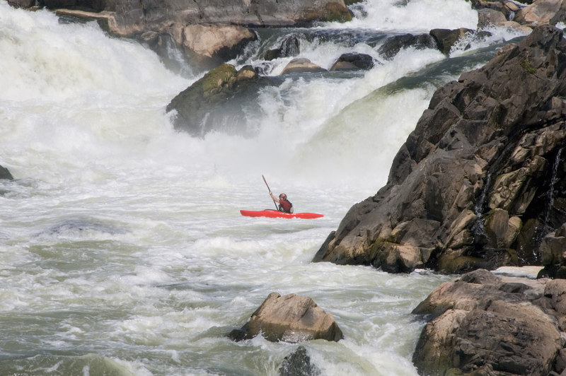 Kayakers decending Great Falls near Washington, DC.
