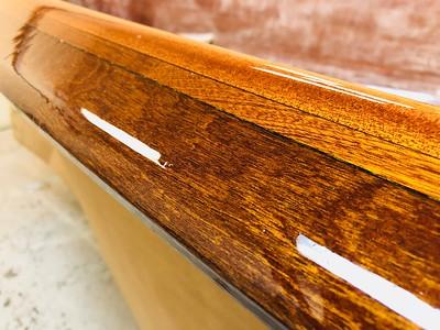 The gunwales shine under numerous coats of varnish