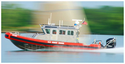 A U.S. Coast Guard vessel rushes up the Detroit River on an emergency call.
