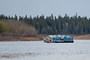 Small tugs take a barge load of fuel to Moose Factory.
