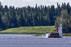 Barge Niska I turning as it exits the channel from Moose Factory.