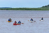 Paddle canoeists arriving in Moosonee after paddling from Otter Rapids.