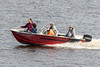 Five people in a boat on the Moose River. 35E13469.