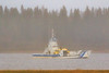 Barge Niska I heads to Moose Factory from Moosonee with a propane truck on a wet and foggy morning. 2017 September 27th. Lightroom dehaze 75.