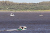 Paddle canoeists heading for Ontario Provincial Police boat on the Moose River.