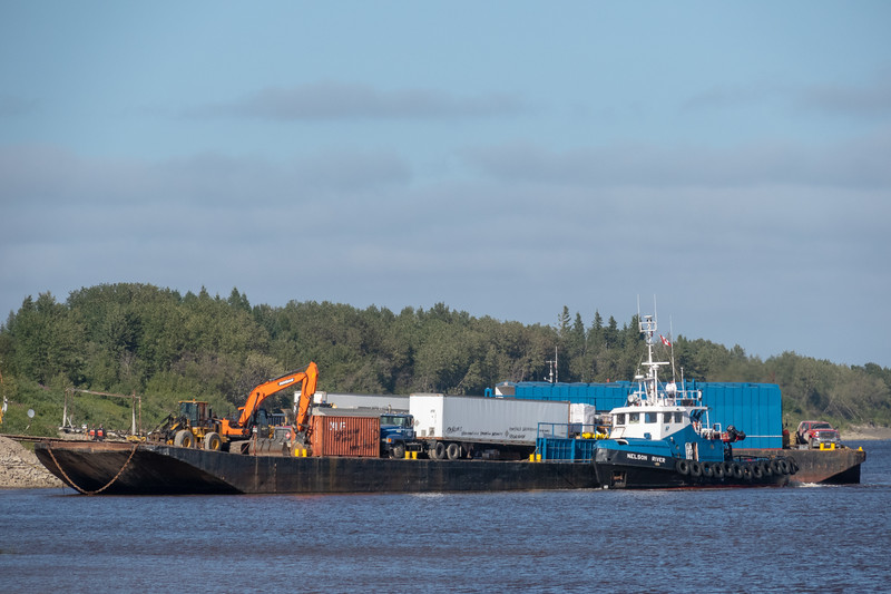 Tug Nelson River working with a barge at Moosonee on the Moose River 2018 August 17.