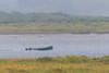Canoe on the far side of the sandbar in the rain.
