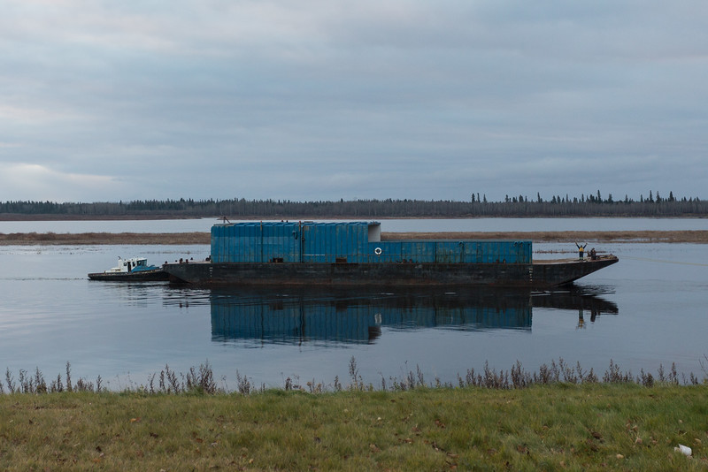 Small tugs move a barge up the Moose River to winter storage at Moosonee. 2016 November 5th.
