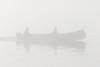 Canoe in morning fog on the Moose River.