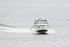 Police boat heading up the Moose River at Moosonee.