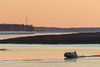 Boat taxi coming to Moosonee from Moose Factory around sunset.