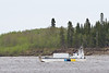 Ontario Northland barge Manitou II returning to Moosonee from Moose Factory 2011 June 8th. Butler Island in background.