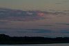 Clouds over the Moose River at dusk at Moosonee, Ontario.