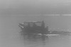 Taxi boat on a foggy morning. Version with more black.