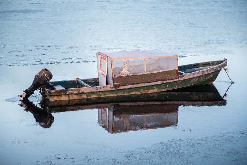 Taxi boat waiting for its driver near public dock site in Moosonee.