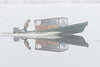Taxi boat coming to Moosonee through the fog.