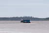 Tug Nelson River and its barge head north from Moosonee.