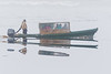 Taxi boat coming to Moosonee reflected in the Moose River.