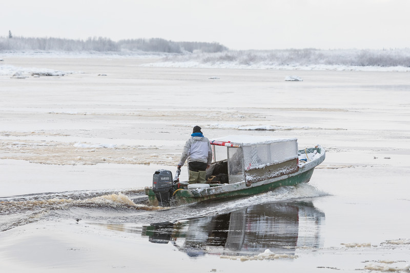 Darren Blueboy drives his taxi boat to Moose Factory.