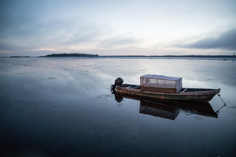 Taxi boat on the Moose River with Butler Island in the distance.