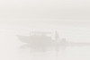 Taxi boat on a foggy morning.