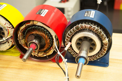 Electric motors with their innards exposed.